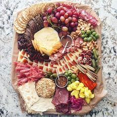 Making a cheese board for #NYE? Here's some inspiration from : @meredithbondsteele  #eattheworld