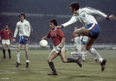 Trevor Brooking of England (right) in action against Portugal during the European Championship Qualifying match at Wembley Stadium in London on 20th November 1974. The match ended in a 0-0 draw.