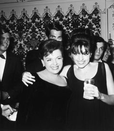 Judy and Liza, George Hamilton in background.
