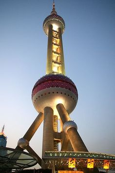 Oriental Pearl Tower, Shanghai (Pudong District) China. It was designed by the Shanghai Modern Architectural Design Co. Ltd. principal designers are Jiang Huan Chen, Lin Benlin and Zhang Xiulin.