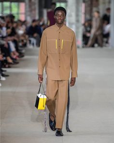 The complete Jil Sander Spring 2020 Menswear fashion show now on Vogue Runway.