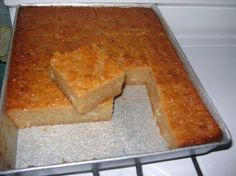 Cassava pone is a Caribbean delicacy made from cassava and used fairly often. the pone is a sweet treat and it is not a cake or a pudding but somewhat in between and is made from root vegetables. Trinidadian Recipes, Guyanese Recipes, Haitian Food Recipes, Indian Food Recipes, Yuca Recipes, Indian Foods, Jamaican Dishes, Jamaican Recipes, Jamaican Desserts