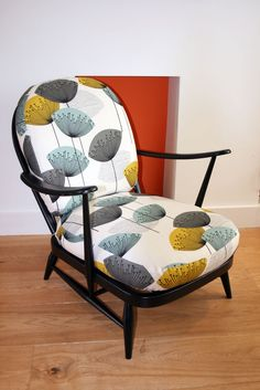 Ercol Windsor armchair with Sanderson Dandelion Clocks fabric and black frame Lara Ford