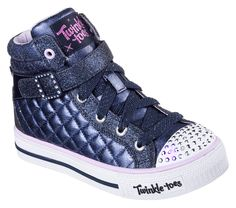 Fun fashion and light up excitement combine in the SKECHERS Twinkle Toes: Shuffles - Sweetheart Sole shoe.  Metallic painted canvas fabric upper in a lace up casual light up high top sneaker with quilt stitching and overlay detail.