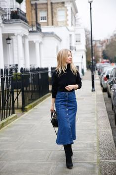The denim midi-skirt is predicted to be one of the big come-backs this season. This is indeed exciting news because the denim midi skirt is extremely versatile and easy to wear. Black Denim Midi Skirt, Full Midi Skirt, Midi Skirt Outfit, Denim Skirt Outfits, Satin Midi Skirt, Denim Outfit, Dress, Skirts With Boots, Street Style