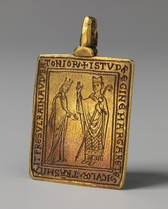 Reliquary Pendant, 1174–77 English Gold;  Within a decade of the martyrdom of Thomas Becket, Bishop Reginald of Bath presented this small pendant, which then contained minute relics of the saint's bloodied vestments, to Queen Margaret of Sicily.