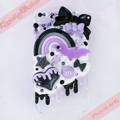 This listing is for a Custom Handmade iPhone 4/4S Decoden Case -- A clear acrylic back-case drizzled with glossy purple and black glittery icing, topped with white whipped cream and sparklies, with a gothic lolita lilac & black theme.   The pretty and cute lolita rainbow was handmade by Miss Ki...