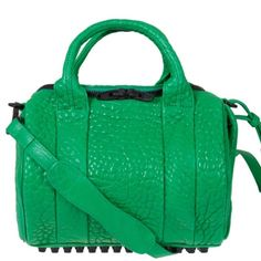 "NEW ALEXANDER WANG Green Astroturf ROCKIE Leather Guaranteed Authentic. Org retail: $900. New, never worn. Matte black hardware for the zippers, dog clips and the bottom studs. A little bit of scratching/fading on the bottom studs due to store handling. Adjustable and detachable shoulder strap. Generous opening to reveal large compartment, with an interior zip pocket, and two slip pockets. Interior is lined with fabric. Exterior has two hidden zip pockets. Comes with dustbag. 10""L, 9""H, 8""W…"