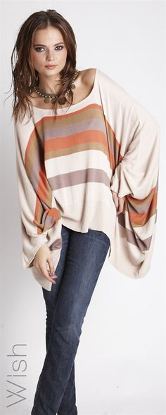 Maverick Poncho  Awesome winter-warmth is coming your way. The Wish Maverick Poncho exudes the on-trend poncho vibe of the season. Featuring season-perfect colours and super comfort. Perfect for making a splash at the office while wearing a simple knit.    100% Rayon