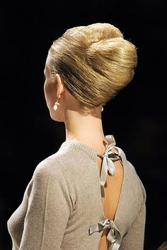 Prada sweater with bows, and classic French twist.