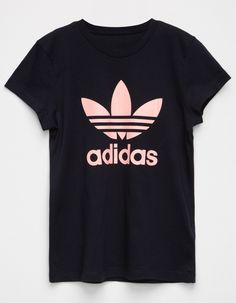 This classic Adidas logo tee is a closet staple. Crafted with an ultrasoft knit, it features a short sleeve, crew neck design. Step up your street style game with these staple Adidas pieces. Adidas Outfit, Adidas Shirt, Adidas Logo, Nike Shirts For Girls, Girls Tees, Sport Outfits, Kids Outfits, Kids Girls Tops, Adidas Fashion