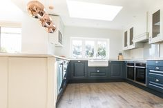 A copper, grey and blue colour palette was chosen for this new kitchen design.  The Oxford blue and copper create a complementary combo that's vibrant and rich.  Working with the client, we created a design that contrasts the Mackintosh Sculptured doors painted in Oxford Blue and White Mackintosh Sculptured doors.   #copper #coppertones #copperpendants #bluekitchen #kitchendesign #newkitchen #traditionalkitchen #mackintoshkitchen
