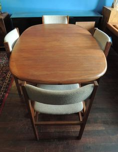 mid century Danish teak dining set with table and four chairs