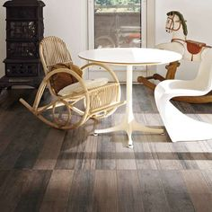 Tile modern luxury slate tiles inspired by natural stones. Ardoise Rex includes large sizes as well as mosaics and laths. Kitchen Renovation, Tiles, Flooring, Furniture, Rocking Chair, Tile Design, Home Decor, Wood Tile, Dining Table