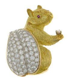 A diamond and eighteen karat gold squirrel brooch with ruby eye; estimated total diamond weight: 2.90 carats; mounted in eighteen karat gold