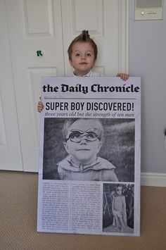 Super hero room. Love the idea of the newspaper... Would be cute to hang in his bedroom