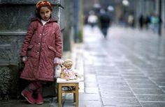 'Little girl selling her dolls for bread – Sarajevo, Bosnia–Herzegovina' by Reza Deghati, december 1993