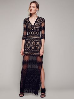 Phantom Maxi Dress | Gorgeous sheer mesh maxi dress featuring eye-catching embroidery allover and dramatic side slits. Scalloped V-neckline with cute center cutouts. Half lined with a nude slip. Hidden back zipper closure.