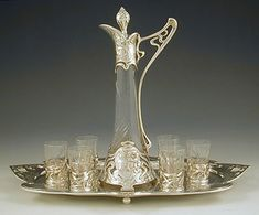 Silver-plate and cut glass liqueur set comprised of a liqueur bottle with maiden profile and six glasses on a matching tray ~ Germany ~ 1906