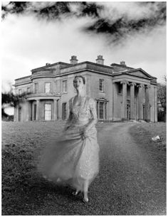 Della Oake wearing a Norman Hartnell gown in Clytha Park, 1951 Photo Norman Parkinson