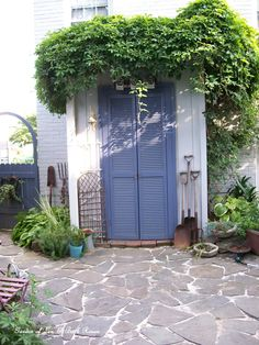 Potting shed w/ recycled shutter doors and bluestone patio we laid.