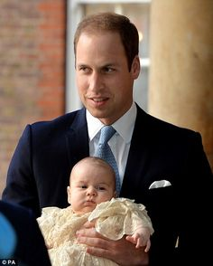 The Duke of Cambridge arrives, holding his son Prince George