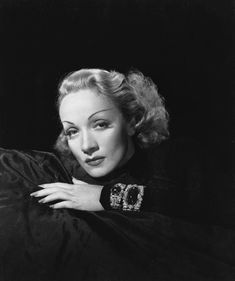 Marlene with two of her most famous pieces of jewellery, her bracelets. Big, bold and...