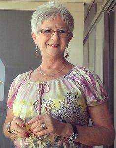 trendy short haircut for older women, like her little spikes.
