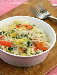 Pineapple lends a refreshing tangy taste to this spiced rice, enough to get your taste buds reviving.