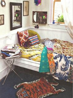 Multiple patterns in a hippie bedroom setting. Plus faux tiger rug!
