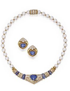 18 KARAT GOLD, SAPPHIRE, DIAMOND AND CULTURED PEARL NECKLACE AND MATCHING EARCLIPS, BULGARI. The necklace composed of 32 cultured pearls spaced by gold rondelles, the front set with a heart-shaped sapphire and four oval cabochon sapphires, accented with round, baguette and square-cut diamonds. signed Bulgari; the earclips set with two heart-shaped sapphires accented by round, triangle and trapeze-cut diamonds, signed Bulgari