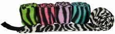 "Showman Zebra Print Polo Wrap Set . $14.99. Zebra Print Polos! Showman zebra print fleece polo wraps with velcro closure. Comes in Lime Zebra, Pink Zebra, Purple Zebra, Teal Zebra, or Zebra. Measure 4"" X 118"". Set of 4."