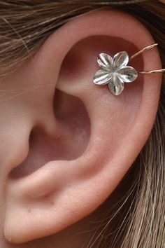 Hey, I found this really awesome Etsy listing at http://www.etsy.com/listing/127853682/big-plumeria-cartilage-ear-cuff-gold