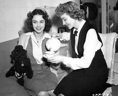 """Jennifer Jones and Claudette Colbert are having a tea break during the filming of """"Since You Went Away"""", 1944."""