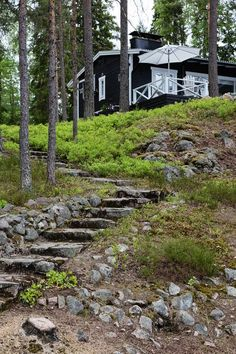 hand-hewn stone steps lead to a cottage painted black with white trim Cozy Cottage, Garden Cottage, Cottage Homes, Lake Cabins, Cabins And Cottages, Dark House, Garden Steps, Beach Shack, Hamptons House