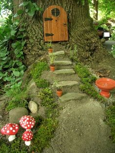 A fairy door to her home in the tree with mushroom decorations