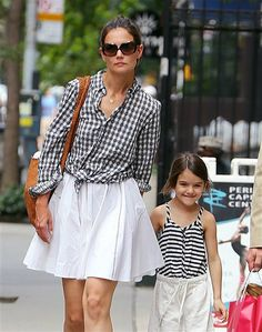 "Katie Holmes didn't have time for lunch, ice cream, grocery run or a museum date with daughter Suri Cruise on Friday.  Instead, the ""Romantics"" actress, 33, spent the bulk of the day at the midtown Manhattan office of her attorney.  Holmes and her legal team certainly have a lot to talk about: She filed for divorce from superstar Tom Cruise June 28, and boldly asked for sole legal custody of Suri, 6."