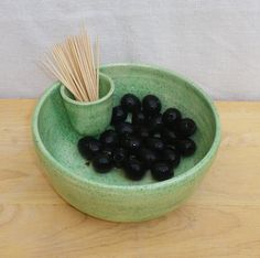 What could be better for any party than a dish of lovely olives to pass around. This olive dish was thrown by me on my pottery wheel using strong