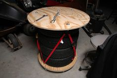Work table made from plywood, tires, casters, and a couple tie down straps.
