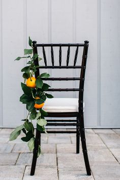 Fruit chair décor | Photography: Rebecca Read Photography - www.rebeccareadphotography.com Read More: http://www.stylemepretty.com/2015/05/27/a-sunshine-state-inspired-wedding/