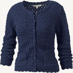 Yin: Soft knit construction. Scalloped edges. Round buttons. Yang: darker color. Square pockets.