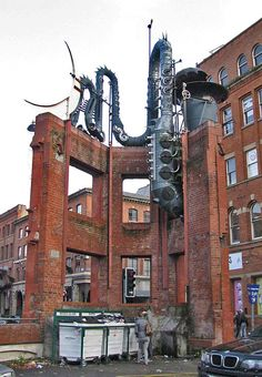 Dragonlike - The Big Horn Sculpture by David Kemp - It's not really a saxophone, nor a dragon, coiled on the gothic stump of a Victorian hat factory in Manchester Manchester Northern Quarter, Street Art, Graffiti, Manchester England, Salford, Interesting Buildings, Victorian Architecture, Travel Tours, Public Art