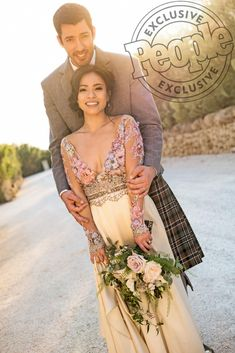 """After getting engaged in December 2016, Drew Scott and his longtime love, Linda Phan,have finally tied the knot! They celebrated with a whimsical outdoor ceremony with over 300 guests. """"Today couldn't have been more magical,"""" the couple exclusively told"""