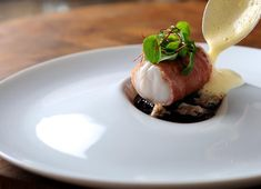 Monkfish wrapped in Parma ham, with red wine jus, lemon sabayon and cockles