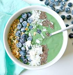 mermaid smoothie bowl, green with blueberries, coconut and chia seeds