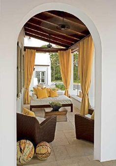 porches - daybed rattan chairs entry porch yellow and brown outdoor living area.