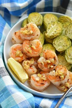 Healthy One Pan Lemon Garlic Shrimp & Brussels Sprouts! An amazing flavor combination of tender, garlicky shrimp that comes together in 20 minutes!