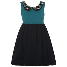 This adorable dress by RMLA will give your little girl a modern allure and will bring out a sporty touch. Stretch ponte dress features a jade turquoise sleeveless bodice with a jeweled collar and a pleated black skirt. This trendy style will work day and