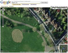 Finger maze in Hove Park in the UK – an art piece created by artist Chris Drury.  The thumbprint is constructed from York stone inlayed into the turf.