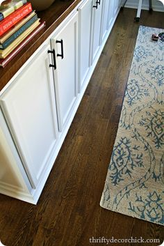 The floor color is Jacobean by Minwax...